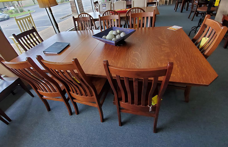 The Amish table is made of quarter sawn oak and comes with 4 chairs