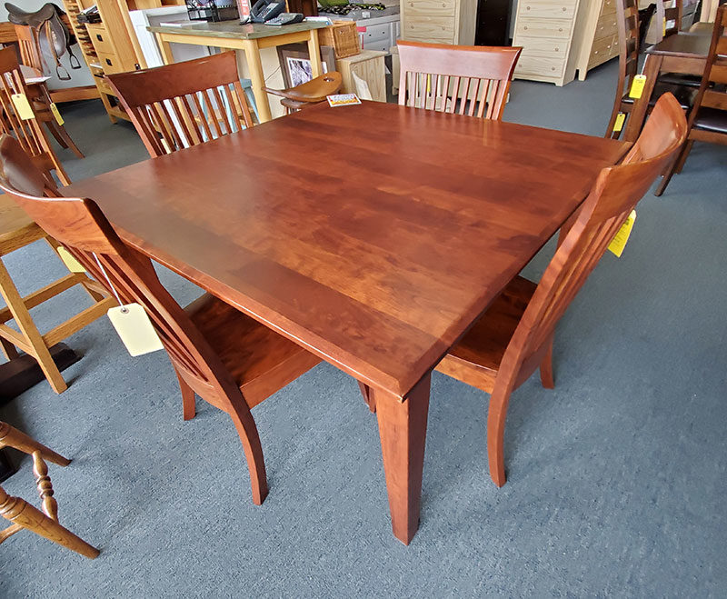 The Amish table is made of solid cherry and comes with 4 chairs